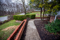 Concrete Walkway and Retaining Wall installation by D-Bug Waterproofing