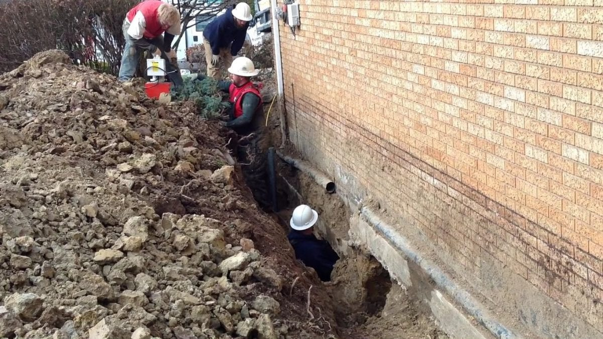 D-Bug Waterproofing crew hard a work on a home