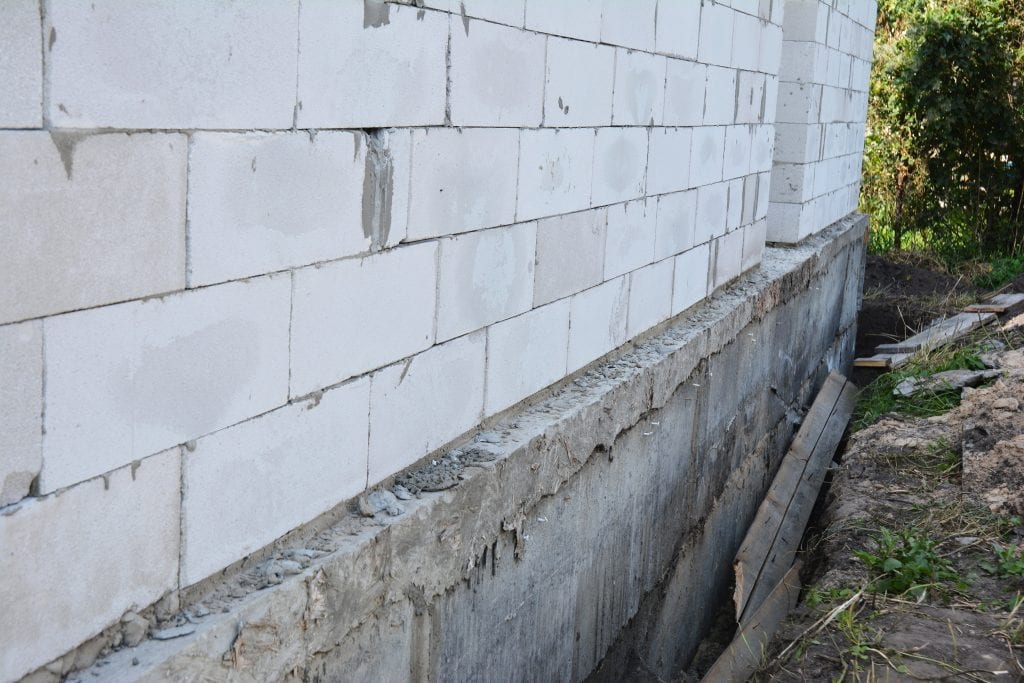 Installing a french drain in basement d bug waterproofing - Exterior foundation insulation panels ...