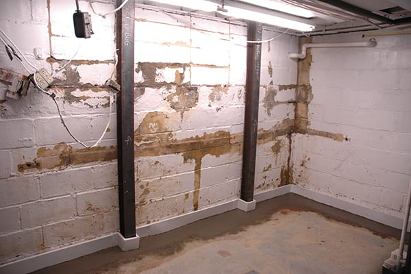 D-Bug Waterproofing installed steel beams to combat basement wall bowing