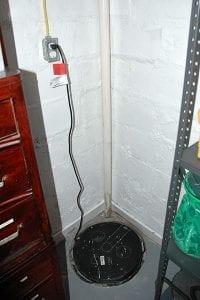 D-Bug Waterproofing sump pump installed in basement