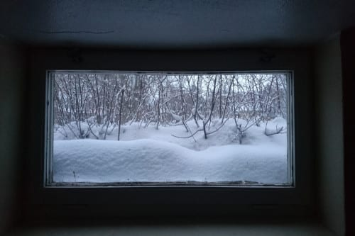 Snow building up outside window