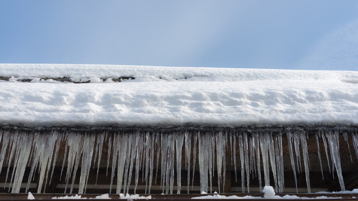 Ice dams on gutter of home